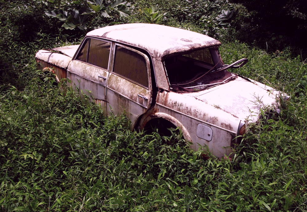 A-Rusty-Pink-Abandoned-Car-In-A-Field