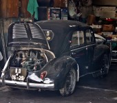 An-Old-Car-With-Its-Boot-Open-In-A-Garage
