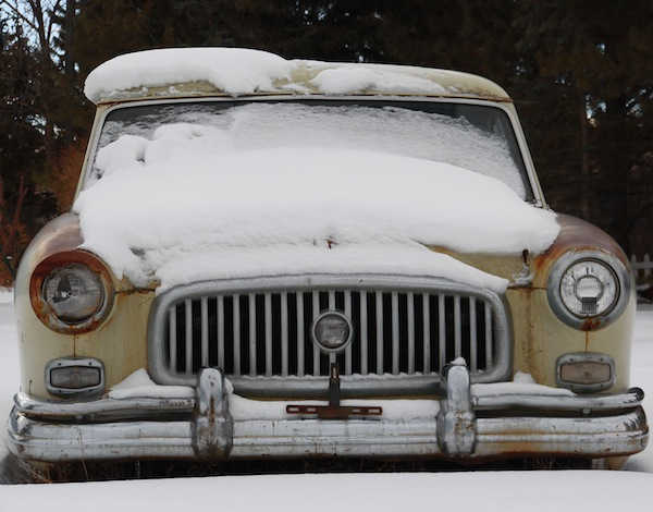 Classic-Car-Covered-In-Snow
