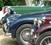 Fronts-Of-Four-Classic-Cars-In-A-Line